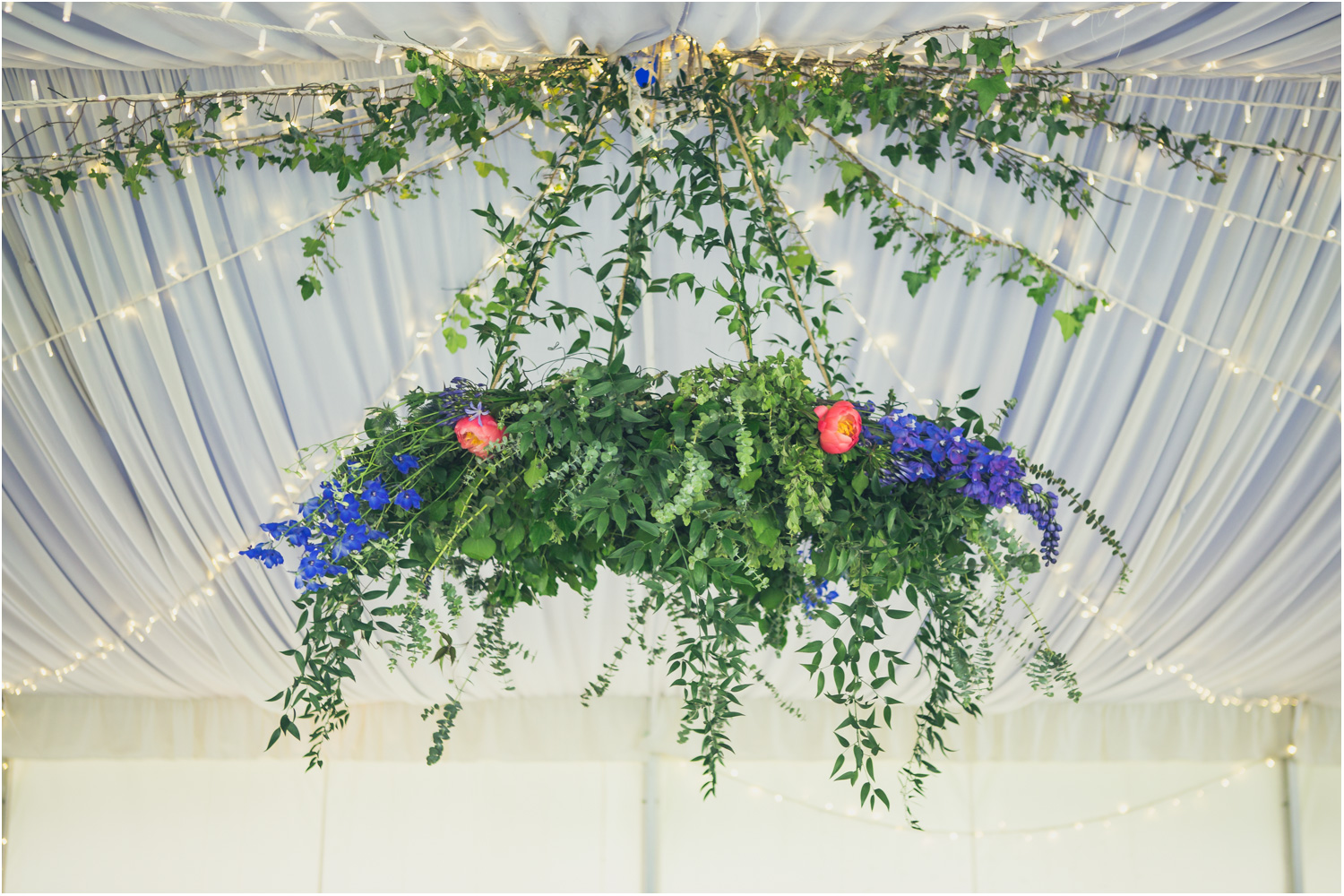 12 blue larkspur and pink peonies in green garland