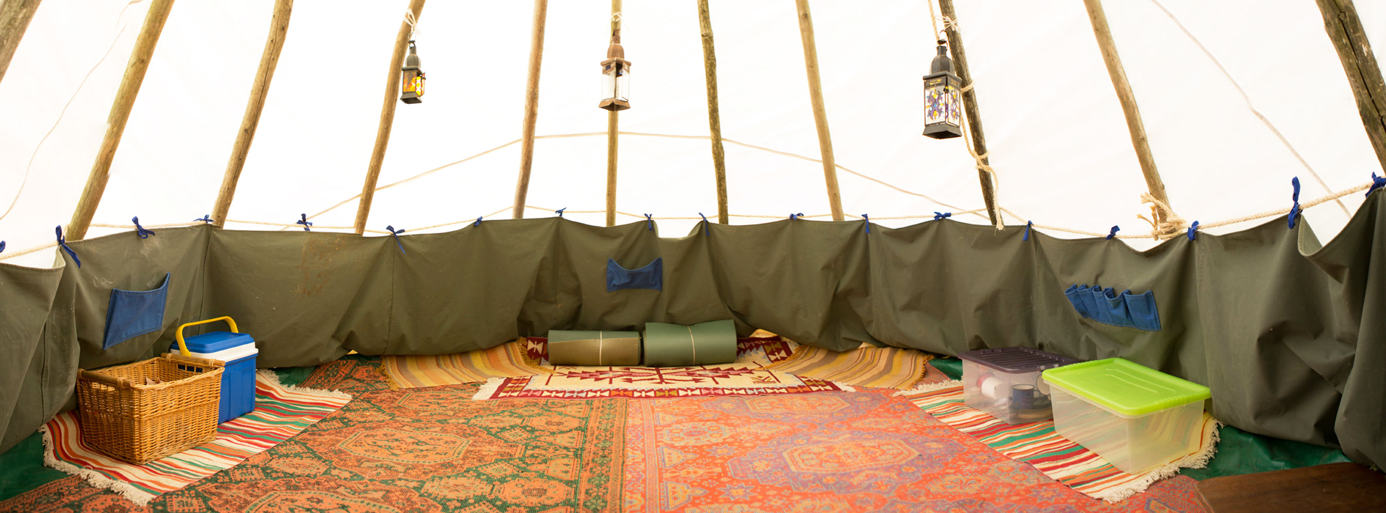 Tipi interior rugs, lanterns, cooking equipment, bedrolls