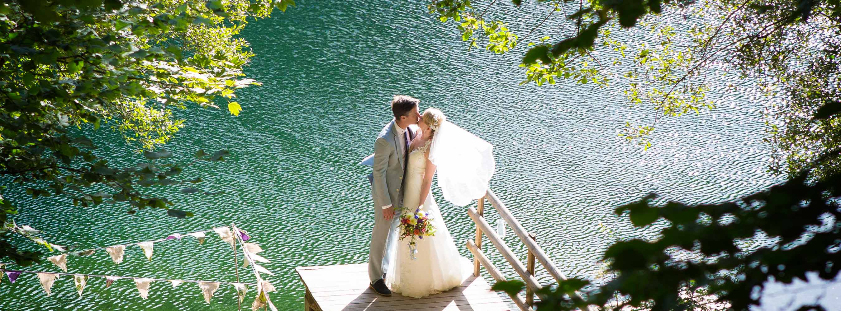 Wedding Couple at Lake Jetty with veil
