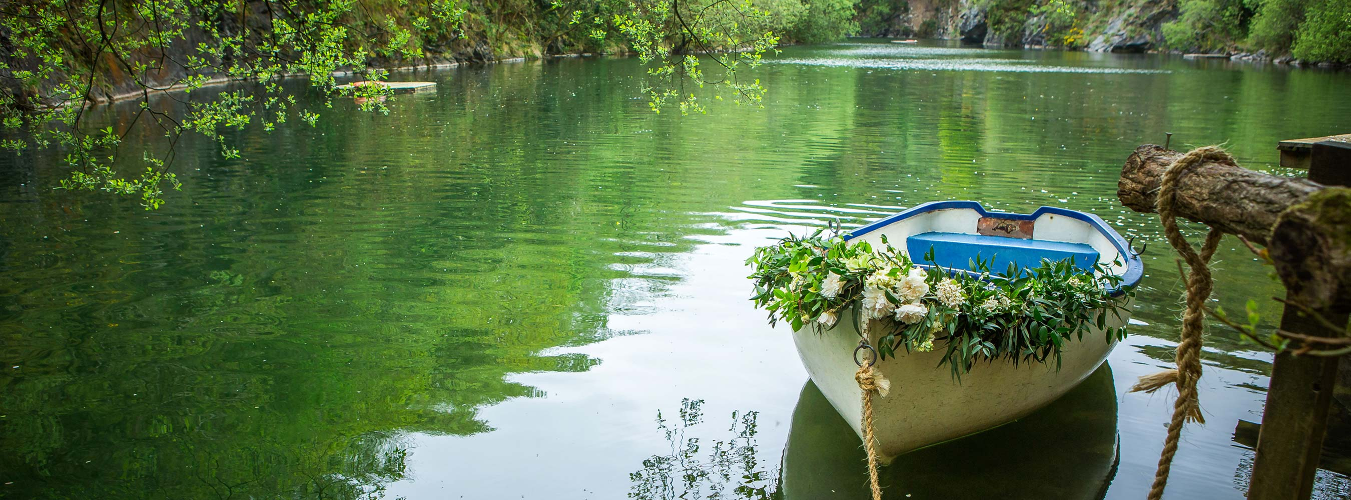 Decorated Boat with flowers at lake