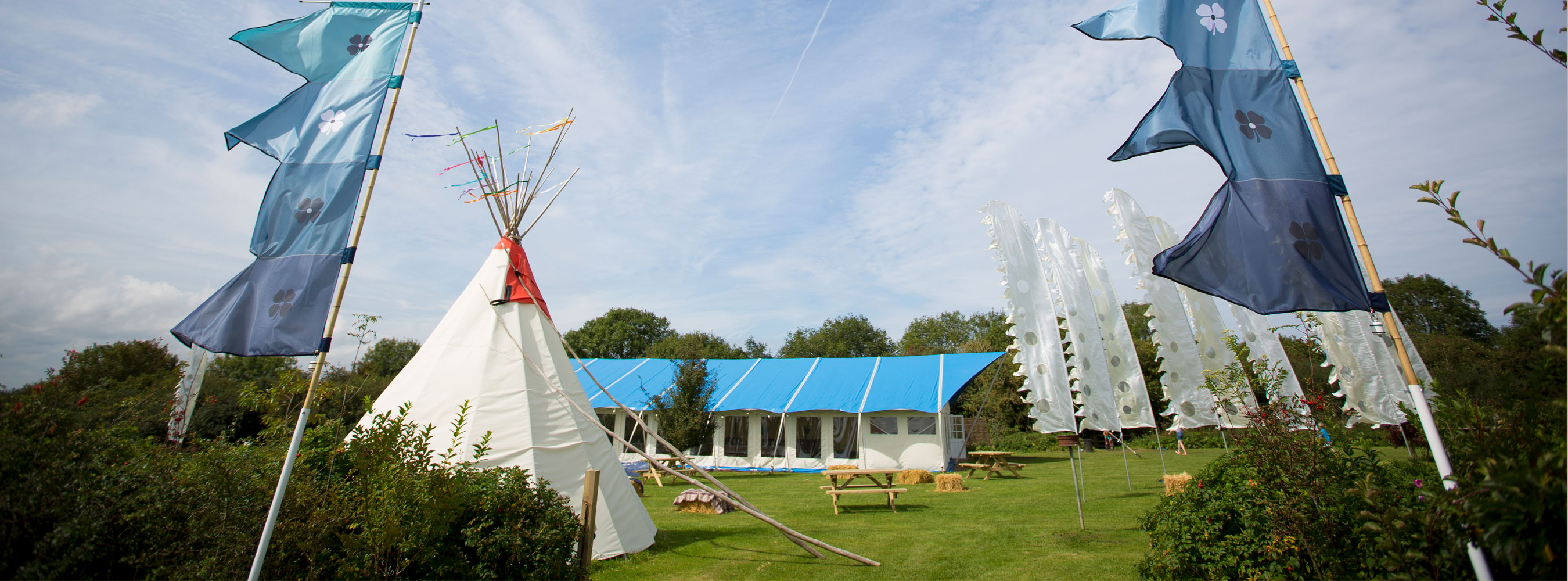 Marquee Meadow festival flags tipi